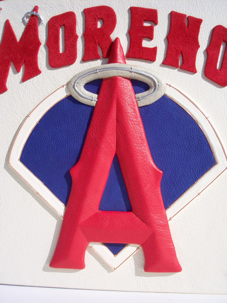 closeup of leather bound book with Moreno name LA Angels leather embossed logo