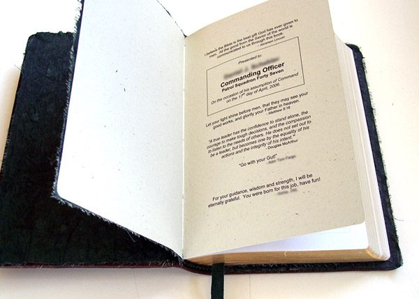 Leather Bible with sewn in added printed text pages