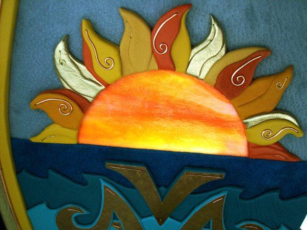 illuminated orange stained glass half circle window as sunset with leather sunrays
