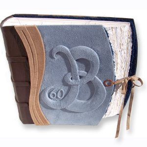 blue suede 60th anniversary book with initial