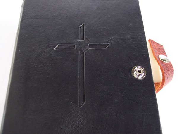 black leather Bible with Inset cross under with snap closure