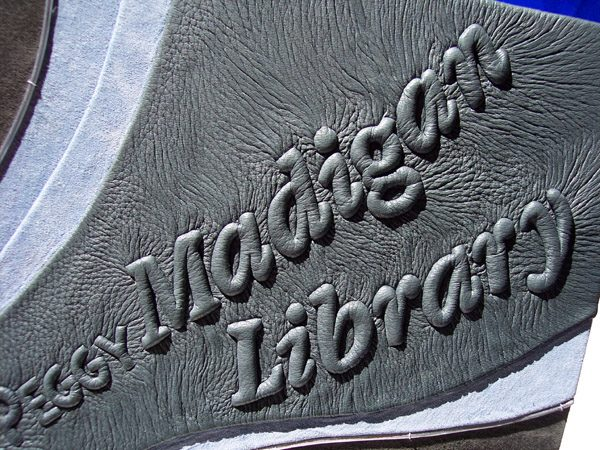 Madigan Library Leather Book with carved embossed lettering