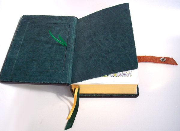 Hidden compartment inset within inner Bible cover