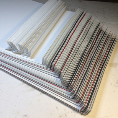 Stacked pages for handbound leather book, ready for sewing