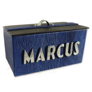 Blue leather box with black lid, metal handle, and silver capped name Marcus