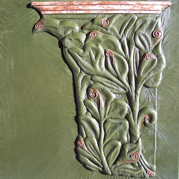art nouveau carved celery leaf design as a pillar with copper on green leather La Plante custom book cover