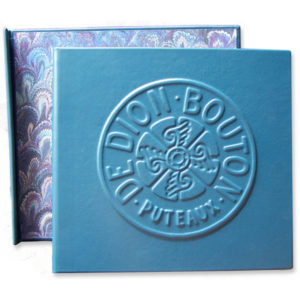 Antique classic car turquoise leather scrapbook with car logo De Dion Bouton embossed on the cover