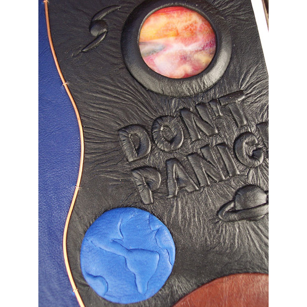stained glass planet and embossed earth on custom leather Hitchhiker's Guide to the Galaxy book cover, Don't Panic lettering