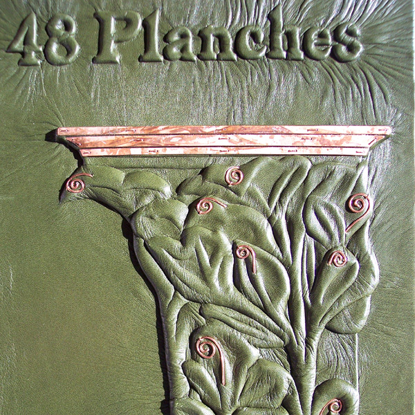 carved embossed celery leaf pillar in Art Nouveau style on leather book cover
