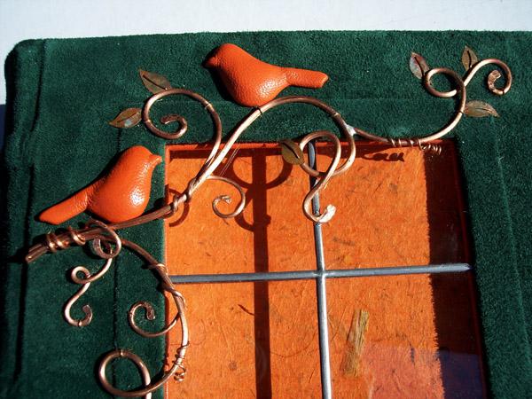 orange birds on copper vines on green leather door wedding book