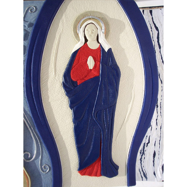 leather Madonna Virgin Mary figurine on leatherbound photo album