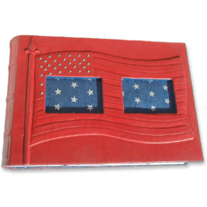 carved embossed USA flag on red leather photo album cover with two cutout windows, blue coversheets with silver stars