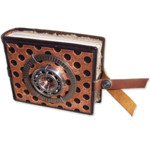 Snapped blank handbound leather journal with car part art - perforated metal plate and two steel roller bearings