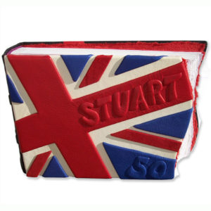 red, white, and blue leather scrapbook made as British Union Jack flag with embossed name Stuart and 50
