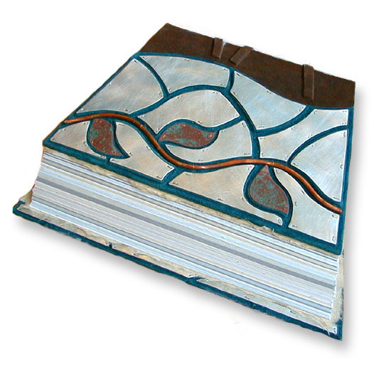askew shaped handbound book with silver mosaic panels around a copper vine