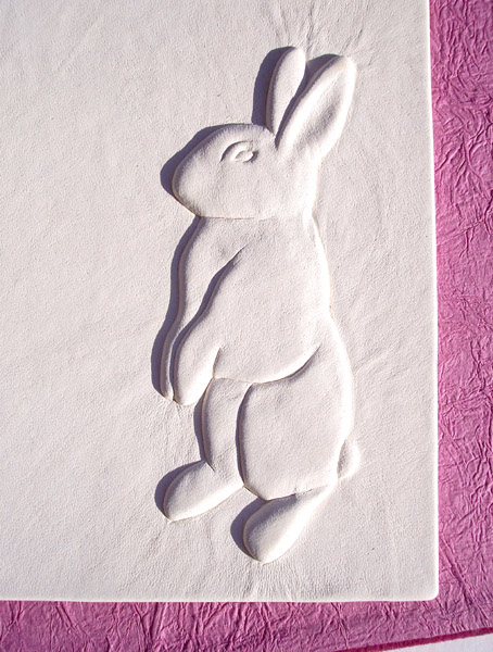 carved bunny rabbit embossed under white leather on book scrapbook cover