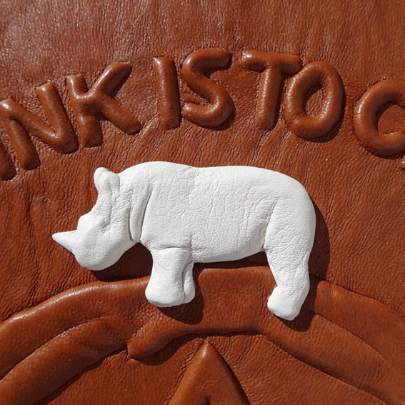 white rhino on custom leather journal