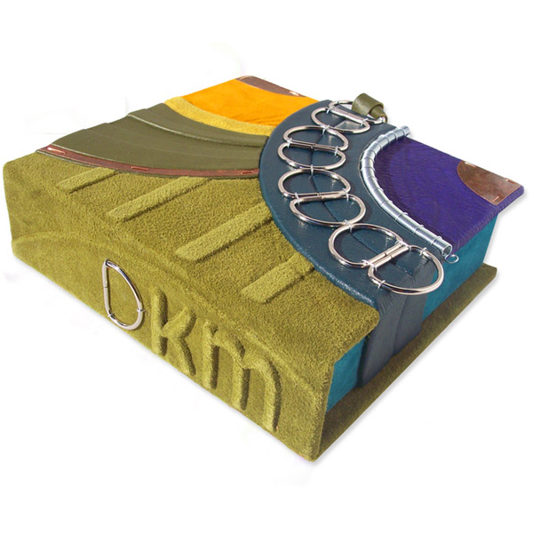 D rings on suede moss green clamshell box with embossed intials DKM