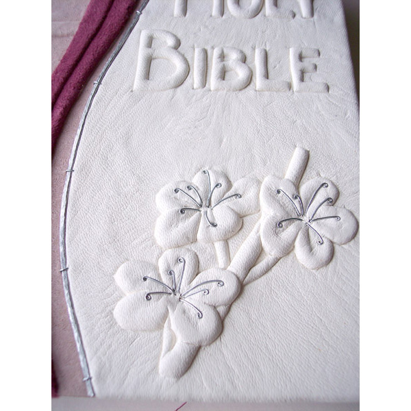 carved embossed cherry blssom under white leather on Holy Bible custom book cover with pink suede