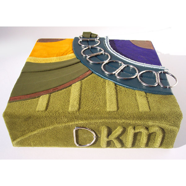 embossed moss green initials DKM on spine of custom leather clamshell box with D ring