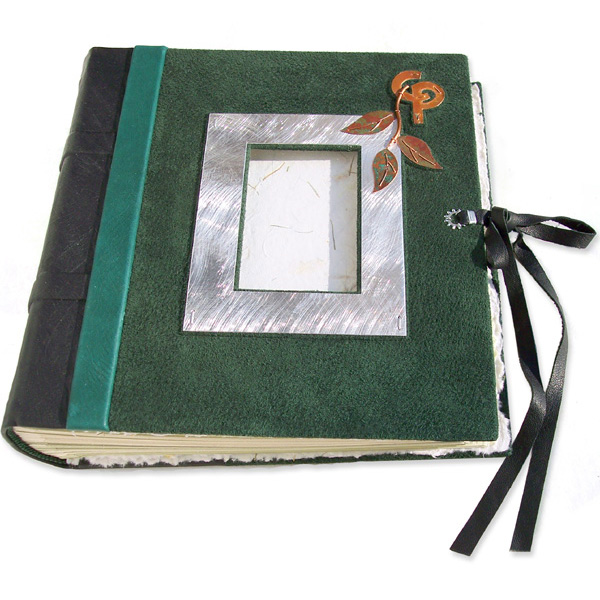 green suede wedding album with silver photo frame, copper vine, linked initials, leather lace closure