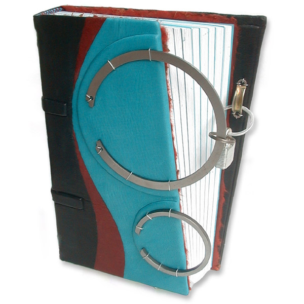 turquoise leather black journal with two steel rings and padlock closure over angled diary edge