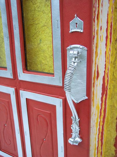handmade metal hardware on door book as leather scrapbook