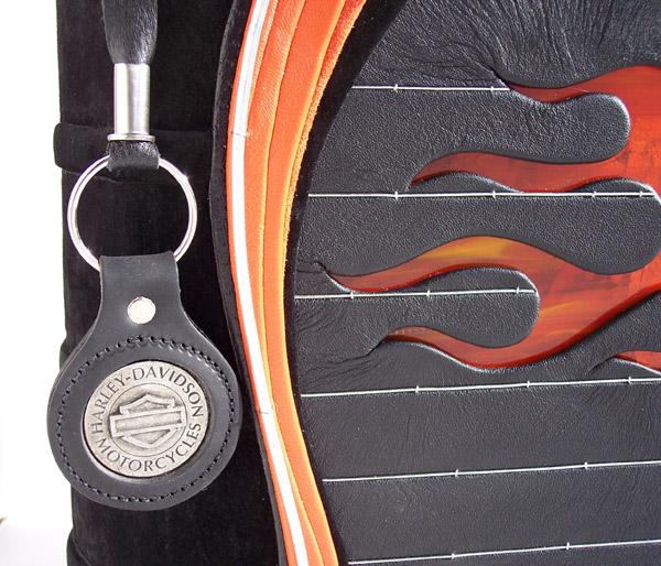 harley davidson keychain used as bookmark on leather scrapbook album