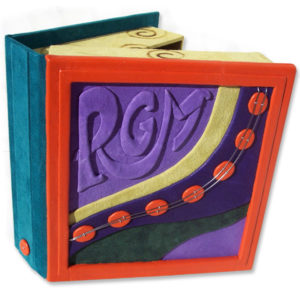 custom bright leather box with embossed purple initials RGM and orange leather dots
