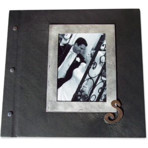 black leather screwpost wedding album with bride and groom photo framed under glass with copper initial S
