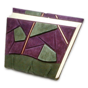 askew cut handbound book in purple and green leather with mosaic and copper