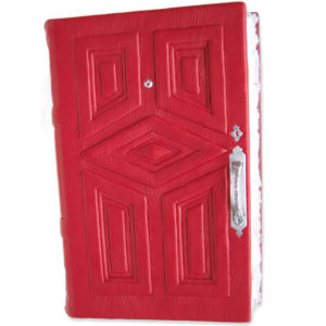 red leather door journal with silver hardware and diamond panel in center