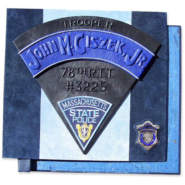 State Trooper Police Scrapbook with name embossed under blue leather, Massachusetts patch, Police badge