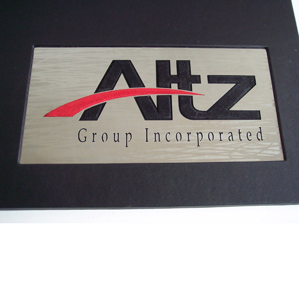 custom stainless steel business emblem over leather portfolio book cover
