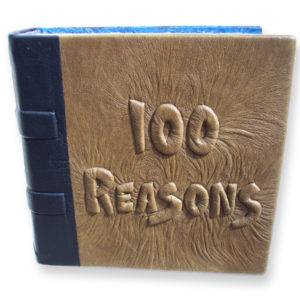 custom brown leather wedding anniversary scrapbook with handcarved and embossed lettering 100 Reasons