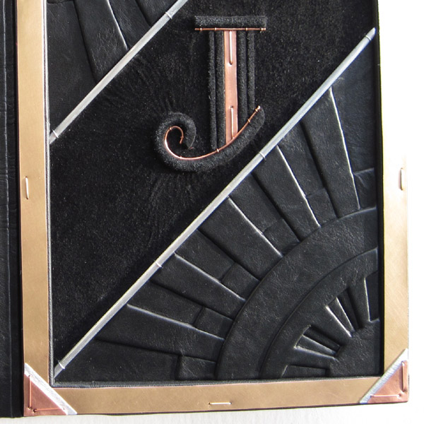 Copper Art Deco initial J embossed on triangle design leather book cover