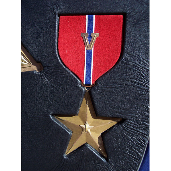 leather and metal sculpted Bronze Star artwork inset into leather Military award book cover