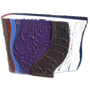 personalized leather scrapbook for Cantor with staff and music notes embossed under leather