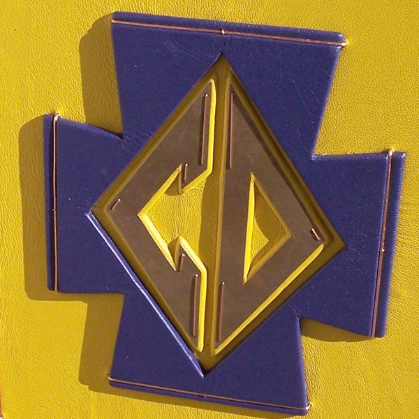Cretin Durham school logo with purple and yellow leather and copper