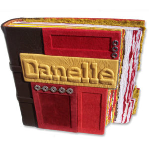 Red and gold mosaic panels on personalized leather photo album with embossed name plate Danelle and stepped book edges