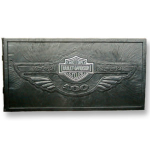 Harley-Davidson 100th Anniversary Book with Bar and Shield logo over black leather