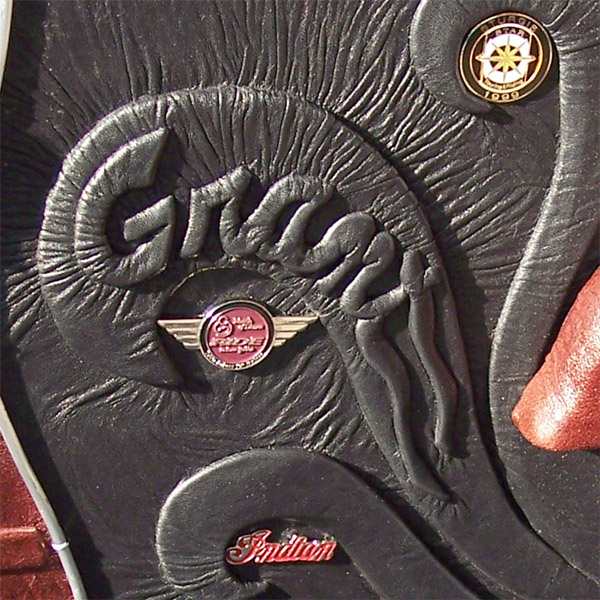 Embossed name Grant under black leather with Indian motorcycle pins on book cover
