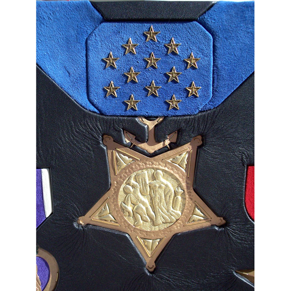 leather and metal sculpted Medal of Honor artwork with metal stars inset into leather award book cover