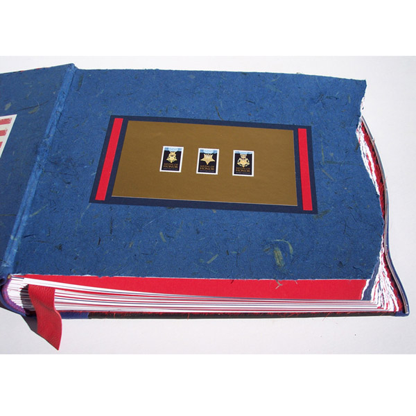 Medal of Honor Postage Stamps as coversheet artwork in custom leather military scrapbook