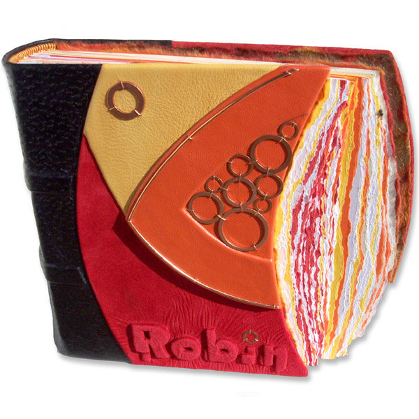 modern mosaic custom leather scrapbook with embossed name Robin in yellow, orange, red and copper washers, all curved edges