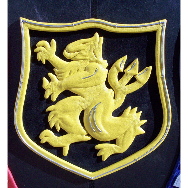 Military Crest artwork on custom book cover wrapping with yellow leather for Navy Seal team