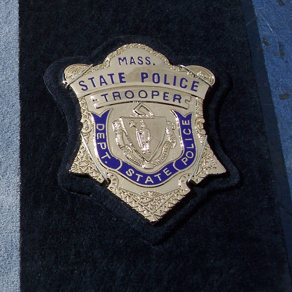 Massachusetts State Trooper Police badge on blue leather book cover