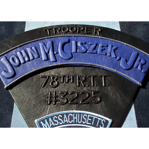 Police State Trooper's name carved and embossed on arched blue leather of personalized book cover