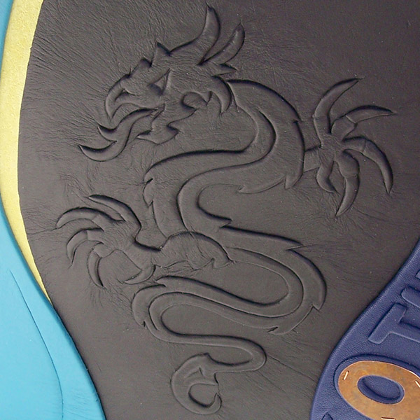 dragon sculpture embossed under black leather on a Year of the Dragon scrapbook album cover