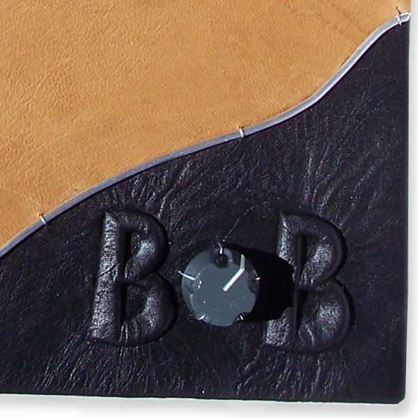 Airplane know as O in embossed black leather name Bob edged with silver wire on leather book cover